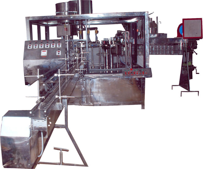 BOTTLE RINSING, FILLING & CAPING MACHINE